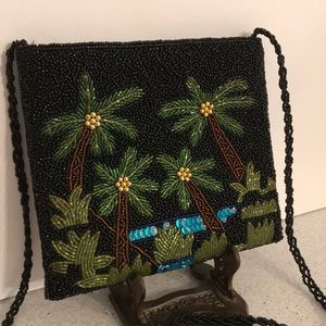 Beaded black evening bag with palm tree motif